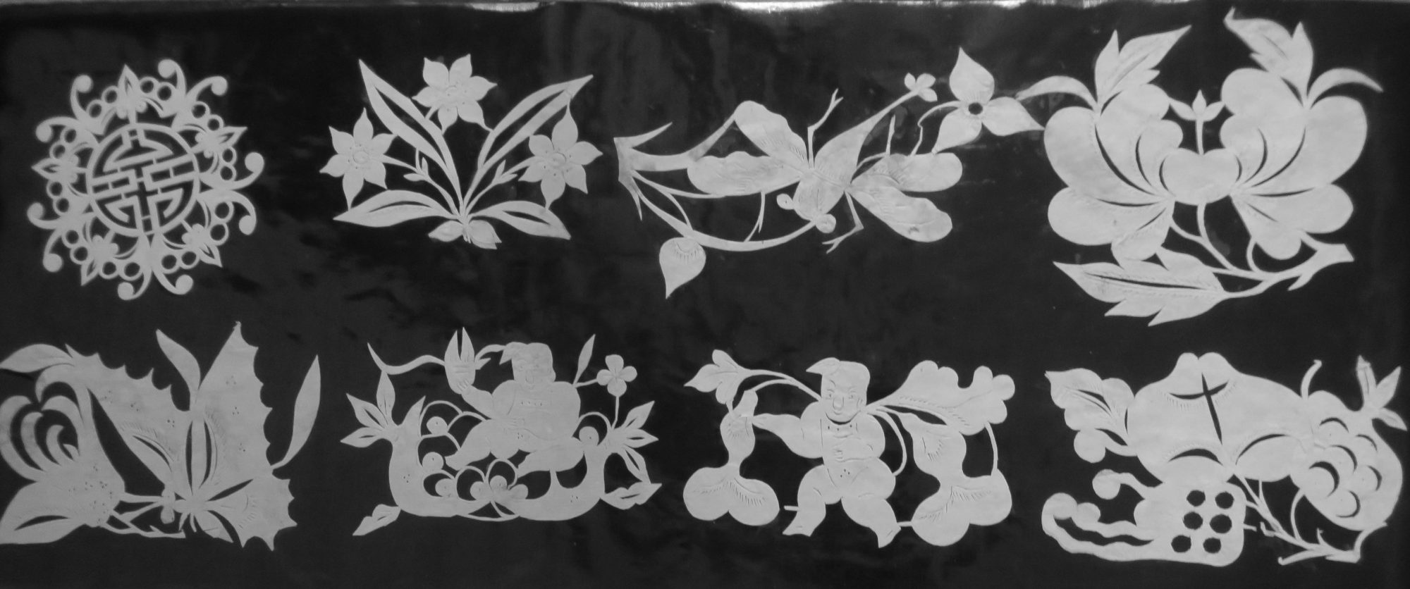 Papercuts probably from Yunnan, 38 x 16 cm.